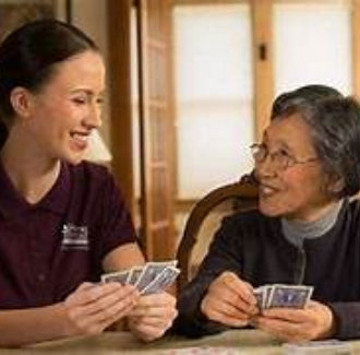 caregiver and senior woman playing