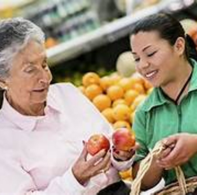 caregiver and senior woman in a supermarket